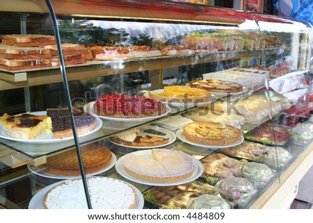 display of delicious looking cakes in a street bar - stock photo