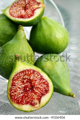 display of figs on glass table - stock photo