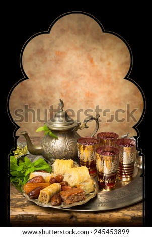 Display of oriental cookies and iftar dates on a Moroccan tea tray - stock photo