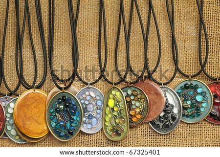display of pendants with  semiprecious stones - stock photo