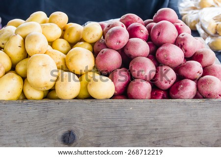 Display of red and white potatoes at the market - stock photo