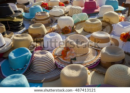 Display of reed hats in a sunny setting