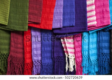 Display of scarfs in a South American Street Marker - Huatulco - Mexico