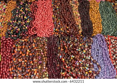 Display of seed neclaces - stock photo