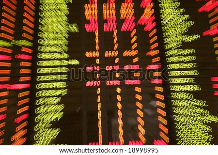Display of share market prices at a share market exchange. - stock photo