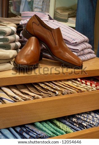 Display of shoes and neckties in modern upscale men's clothing store - stock photo