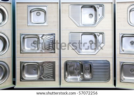 Display of stainless steel kitchen sinks samples - stock photo