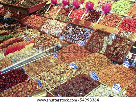 display of various nuts and candy at a market in Barcelona - stock photo