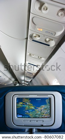 Display screen with the flight information in the airplane - stock photo