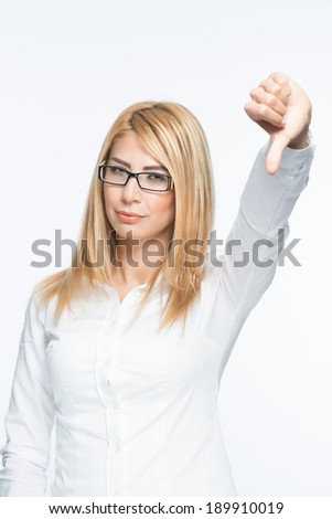 Displeased blonde girl attractive beauty showing thumbs down gesture and posing in front of white background half body shot - stock photo