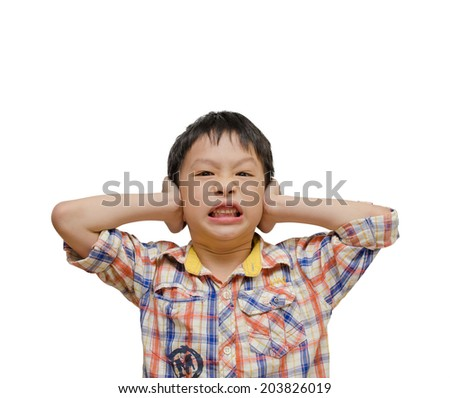 Displeased Boy covering his Ears from the Noise. Isolated on white background - stock photo