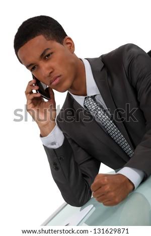 Displeased businessman slamming fist on desk - stock photo