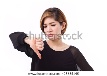 displeased, frustrated, unhappy woman giving thumb down gesture, studio isolated of Asian Chinese-Thai woman model. - stock photo