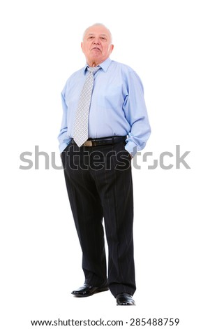 Displeased old mature businessman with tie. put hands in trouser pockets isolated on white background. human emotion, facial expression
