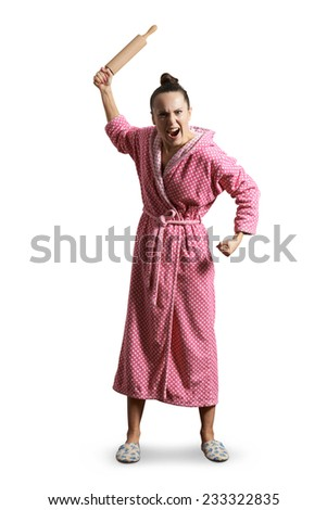 displeased screaming housewife holding rolling pin and looking at camera. isolated on white background - stock photo