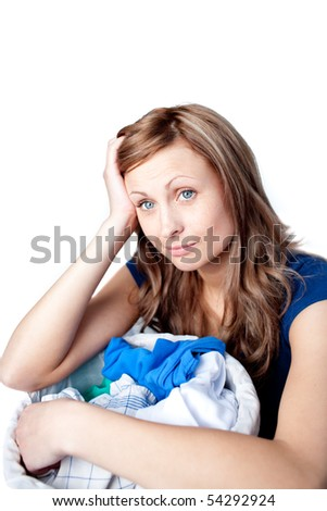 Displeased woman doing laundry isolated on a white background - stock photo