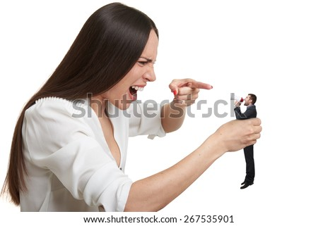 displeased woman holding small man in hand and they shouting at each other. isolated on white background - stock photo