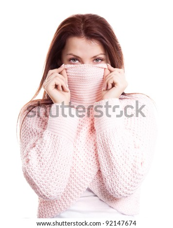 displeased young woman wearing a high neck sweater, isolated against white background - stock photo