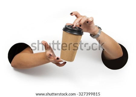 Disposable coffee cup in female hands. Empty for your logo - stock photo