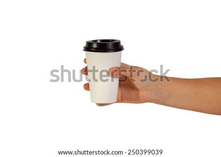 disposable cup of coffee in hand - stock photo