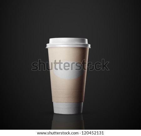 disposable cup of coffee on black background - stock photo