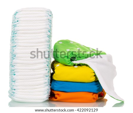 Disposable diapers and eco-friendly fabric isolated on white background.