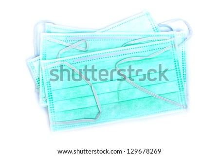 Disposable medical masks isolated on white background