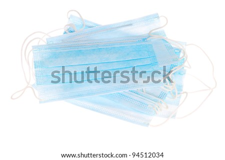 Disposable medical masks isolated on white background - stock photo