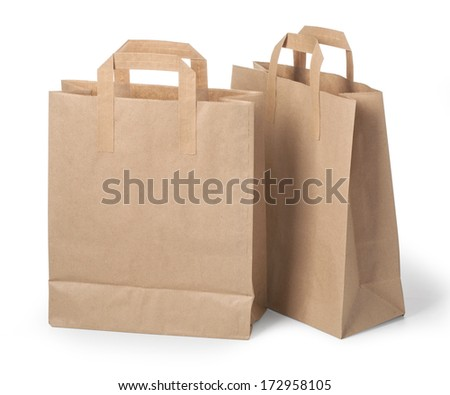 disposable paper bags on white . with clipping path - stock photo