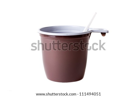 Disposable plastic coffee cup and spoon isolated on white background