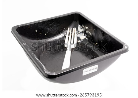 Disposable plastic food container with crumb food, isolated on white background - stock photo
