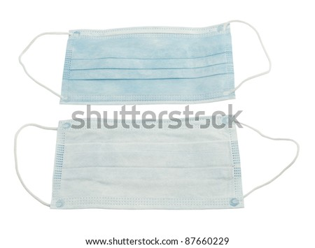 disposable sterile masks-view of both sides on a white background - stock photo