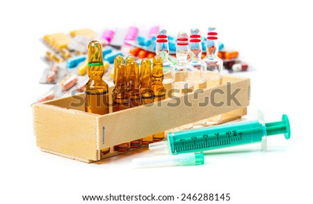 Disposable syringe, ampoules, vaccine, tablets - stock photo