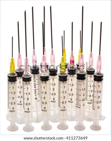 Disposable syringes and needles isolated on white background - stock photo