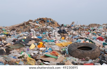 disposed garbage polluting environment - stock photo