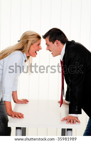 Dispute among employees at work in an office - stock photo