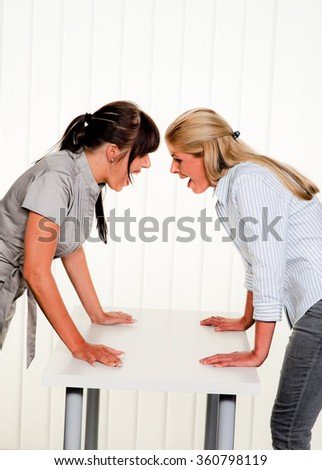 dispute among employees at work in the office