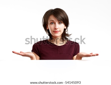 dissapionted beautiful girl behind an empty white board - stock photo