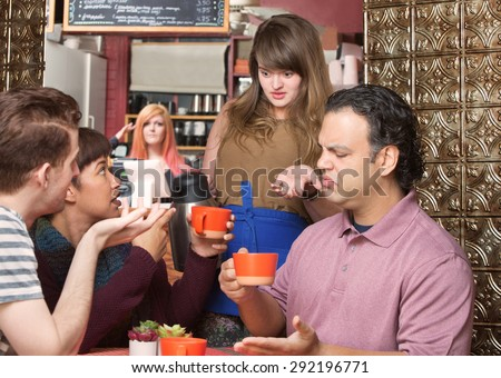 Dissatisfied customers and waitress at coffee house - stock photo
