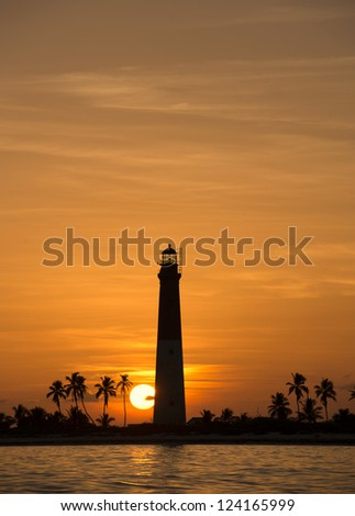 Distance view of a dry tortugas lighthouse at dawn - stock photo