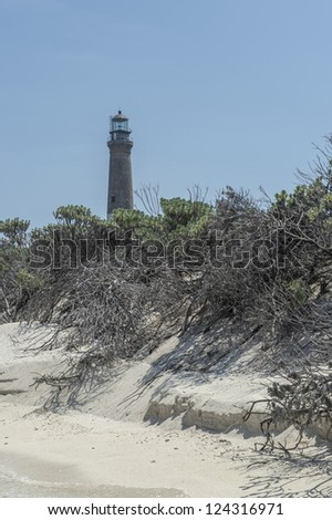 Distance view of a lighthouse in Dry Tortugas, Florida - stock photo