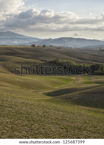 Distance view of barn field in tuscany - stock photo