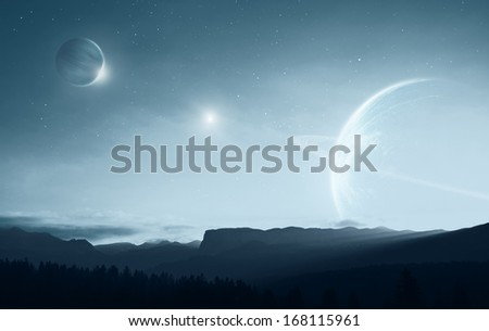 Distant alien world - earth like planet with multiple moons - stock photo
