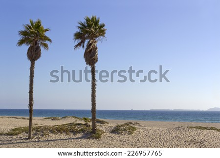 Distant Channel Islands and ocean shore oil rigs as seen from Mandalay Beach, California - stock photo
