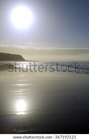 distant cliffs on a sunset beach in county Kerry Ireland