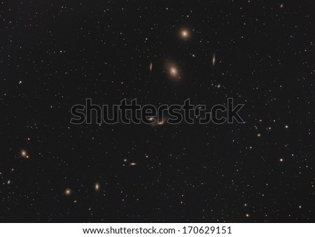 Distant galaxies in space.