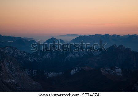 Distant mountain range after sunset in dolomites. View from Piz Boe. Sella. Italy