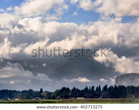 Distant mountains in clouds - stock photo