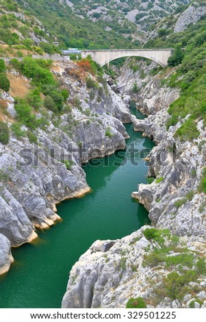 Distant of an bridge above the river near Saint Guilhem le Desert, Languedoc Roussillon, France - stock photo