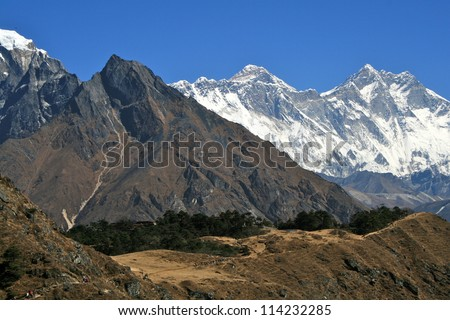 Distant snow-capped peaks in a Blue Sky Himalayan Landscape - stock photo